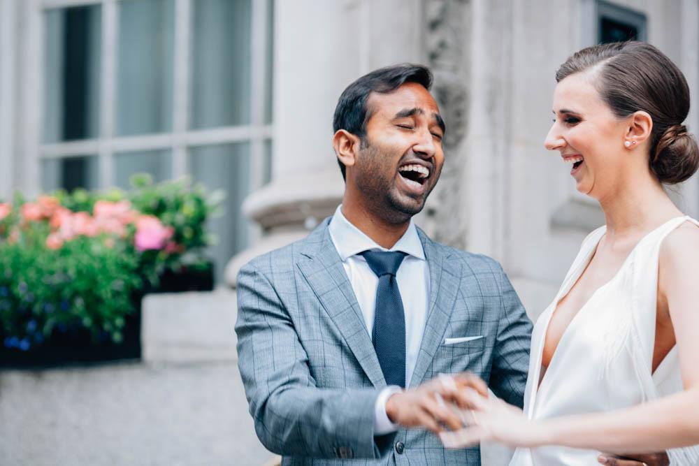 groom is smiling