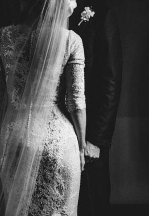 bride holding husbands hand